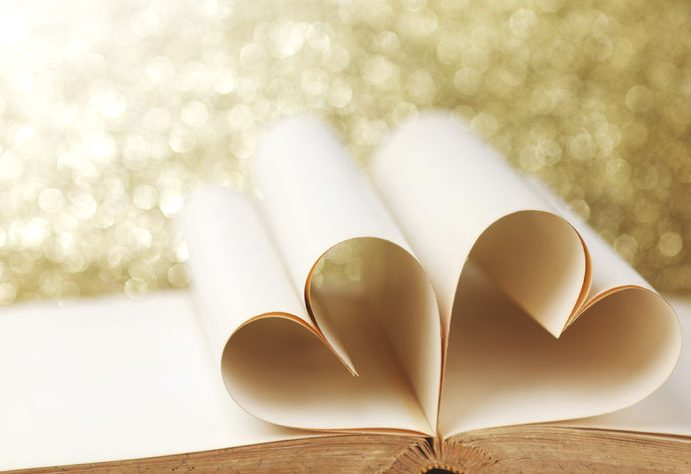 34604309 - heart shaped book pages on glitter background